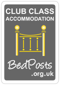 grey badge denoting club class accommodation